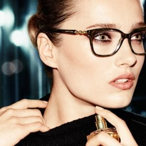 Woman wearing perfume and Michael Kors Glasses