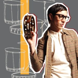 A weird man holding a tambourine and wearing Paul Frank Glasses