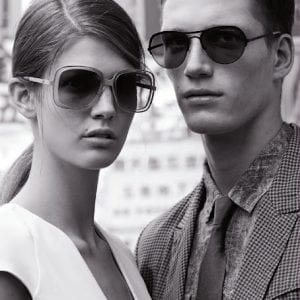 Couple wearing Emporio Armani Glasses