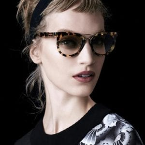 A women in the latest Prada Glasses