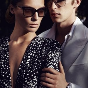 A couple wearing salvatore ferragamo glasses