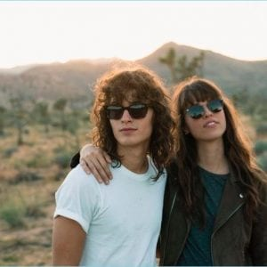 A cool young couple wearing salt glasses