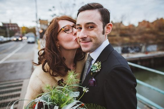 A wedding couple with the woman wearing glasses