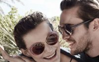 Couple wearing giorgio armani glasses